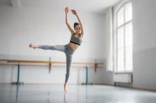 teenage girl dancing ballet in studio