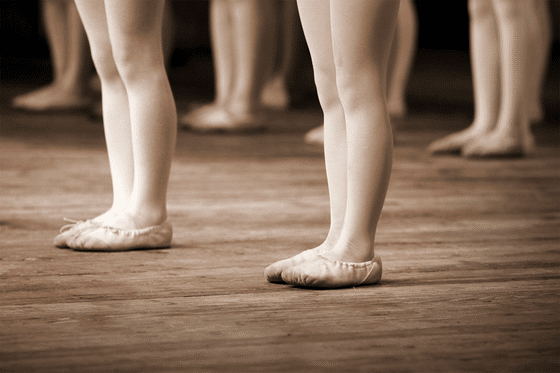 Dancer's feet are show with dance slippers on.