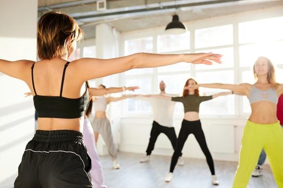 This image shows a teacher leading a dance class.